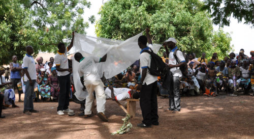 NetsforLife® volunteers use theater as one way to teach about the importance of using an insecticide-treated net to avoid contracting malaria. Here one such play is part of a community gathering, known as a durbar, in Apodabogo in the northern Ghana Anglican Diocese of Tamale. ENS Photo/Mary Frances Schjonberg