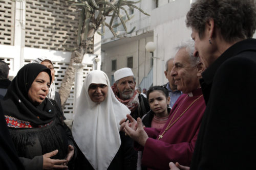 Presiding Bishop Katharine Jefferts Schori and Anglican Bishop in Jerusalem Suheil Dawani listen to a Muslim woman talk about the importance of Al Ahli Arab Hospital on Jan. 2, 2013. ENS Photo/Lynette Wilson