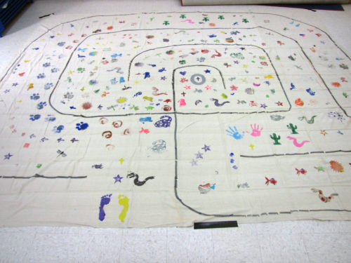 During Lent, members of St. Peter's Episcopal Church in Morristown, New Jersey, drew two labyrinths on 11- by 14-foot canvas drop cloths, then used foam stamps and acrylic paints to decorate the pathways with images of everything from angels and stars to lions, fish, ladybugs and coyotes. A large A was painted in the center of one, an O in the middle of the other, symbolizing God the Alpha and Omega, the beginning and end. On Maundy Thursday, parishioners will have the opportunity to walk the labyrinths as part of their Holy Week journey. Photo/Sharon Sheridan