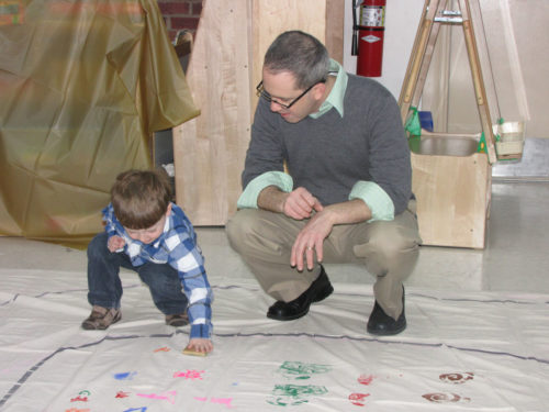 David Joyal and his son, Aidan, stamp patterns on the path of a labyrinth as part of an intergenerational project at St. Peter's Episcopal Church, Morristown, New Jersey. Photo/Sharon Sheridan