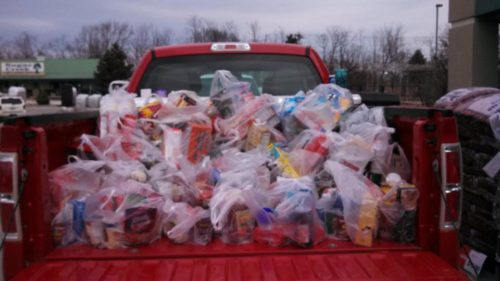 Donors in Kirskville, Missouri, filled almost three pickups with food for the local Christian Community Food Depot on March 23. Photo/Maria L. Evans