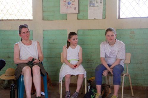 Sarah Hill and her daughters Grace and Zoe during a meeting with community members in El Carmen. ENS Photo/Lynette Wilson