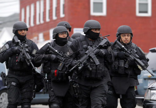 SWAT teams enter a suburban neighborhood to search an apartment for the remaining suspect in the Boston Marathon bombings in Watertown, Massachusetts April 19. Reuters/Jessica Rinaldi