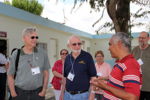 The Rev. Juan Antonio Rosario, right, talks to Dr. Richard Taft, left, and the Rev. Deacon Roger Wood, center, during a visit to San Gabriel, in Consuelo.  ENS Photo/Lynette Wilson