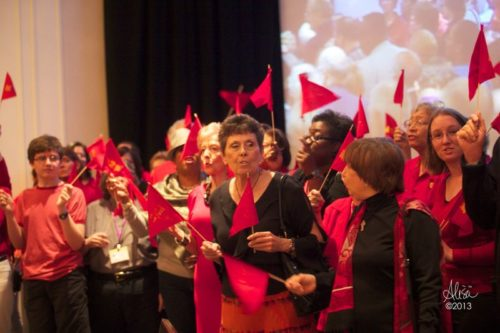 Members of St. Catherine of Sienna Episcopal Church in Missouri City, Texas, arrived at a Diocesan Council meeting earlier this year dressed in red and waving red flags to celebrate the completion of their 14-year journey from mission to parish.