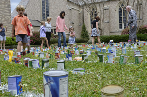 Children help build the labyrinth of canned goods at the St. James' spring picnic in Jackson, Mississippi. Photo: Carolyn Ray