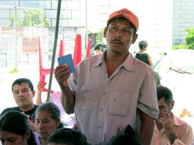 In the 1980s, a civil war fought largely over socioeconomic inequalities and lack of human rights raged in El Salvador. Here, a man holds up a copy of the 1986 constitution, which guarantees many of the rights fought for during the civil war but that oftentimes still are not granted today. Foundation Cristosal is working with Salvadorans to continue the fight for equal rights. Photo: Foundation Cristosal