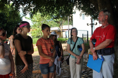 Chuck Stewart interprets for a youth group from the Episcopal Diocese of Central New York during a visit to El Mozote, the site where in 1981 government troops massacred 800 residents of the village. Photo: Lynette Wilson/Episcopal News Service