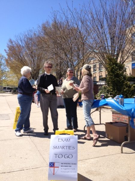 During exams, St. Augustine's Episcopal Church members handed out Smarties and  prayer cards to students at the University of Rhode Island.
