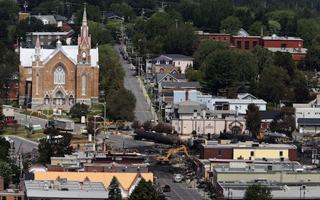 Workers begin digging at the site of a derailment in Lac Megantic, Quebec. A driverless, runaway fuel train that exploded in a deadly ball of flames in the center of this small town rumbled down an empty track minutes after a fire crew extinguished a blaze in one of its parked locomotives.