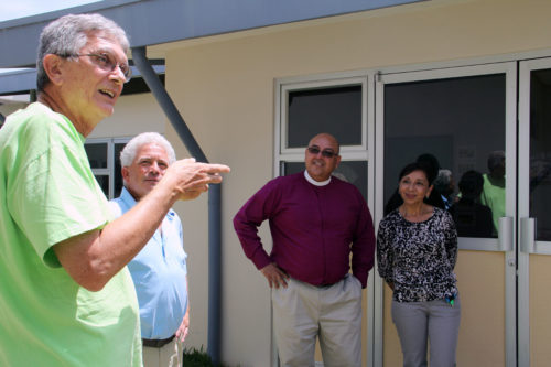 Clarence Fox, left, former diocesan partnership coordinator, talks about the St. Alban's Episcopal Church in Davidson, North Carolina's, role in building the Hogar Escuela in Heredia, as Tom Lambeth, Bishop Hector Montorroso and Sandra Cardona look on. Photo: Lynette Wilson/Episcopal News Service