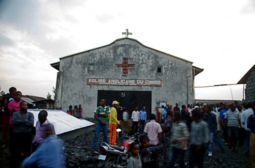 Bystanders gather around an Anglican church that was struck by mortars, wounding at least three, according to one witness, in Goma, eastern Congo, Aug. 22. Neighbors said at least five civilians were hit by mortar fire in Goma during a second day of heavy fighting between government forces and M23 rebels to the north of the town. The violence marked the first reports of civilians being wounded inside the city since late May, and prompted the United Nations peacekeeping mission to issue a statement saying it would take the 'necessary steps to protect civilians.' Photo:Joseph Kay, Associated Press