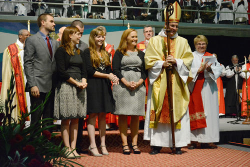 Bishop Whayne Hougland of Western Michigan with his family during his Sept. 28 ordination service. Photo: Karmel Puzzuoli
