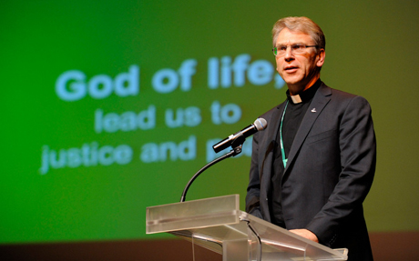 The  Rev. Olav Fykse Tveit, WCC general secretary, welcomes delegates to Busan, South Korea. Photo: Peter Williams/WCC