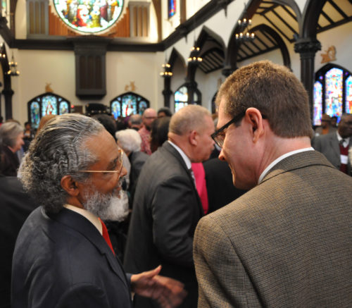 Massachusetts state Rep. Byron Rushing, a civil-rights leader and vice president of the Episcopal Church's House of Deputies, left, speaks Nov. 15 with the Rev. Mark Stevenson, Episcopal Church missioner for domestic poverty, after the end of the opening session of the State of Racism gathering at the Diocese of Mississippi's St. Andrew's Episcopal Cathedral in downtown Jackson. Photo: Mary Frances Schjonberg/Episcopal News Service