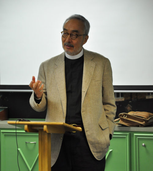 """The Rev. Jim Kodera, a native of Japan and the first Asian-American ordained a priest in the Diocese of Massachusetts, tells a historical narrative of the plight of Asians in America and of Asian Americans during a Nov. 16 workshop that was part of the """"Fifty Years Later: The State of Racism in America"""" gathering at the Diocese of Mississippi's St. Andrew's Episcopal Cathedral in downtown Jackson. Photo: Mary Frances Schjonberg/Episcopal News Service"""