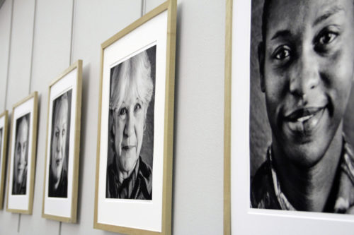 Portraits of the 12 storytellers taken by local photographer Andrew Kilgore hung on the wall at St. Paul's Episcopal Church during the outside performance and were set on wooden easels behind the actors during the inside performance. Photo: Lynette Wilson/ENS