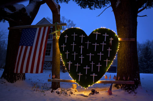 A heart that bears 26 crosses for each victim is surrounded by lights the Sandy Hook portion of Newtown, Connecticut December 14, 2013. Today marks the one year anniversary of the shooting rampage at Sandy Hook Elementary School, where 20 children and six adults were killed by gunman Adam Lanza. Photo: REUTERS/Carlo Allegri