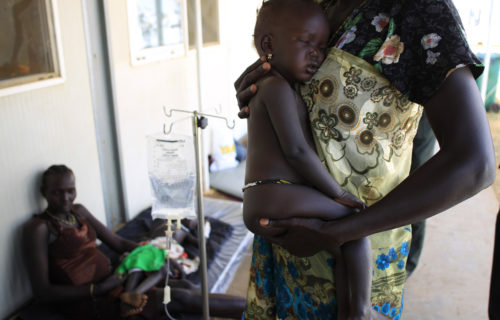 A displaced mother carries her sick child at a United Nations hospital at Tomping camp, where some 15,000 displaced people who fled their homes are sheltered by the UN, near South Sudan's capital Juba Jan. 7, 2014. REUTERS/James Akena