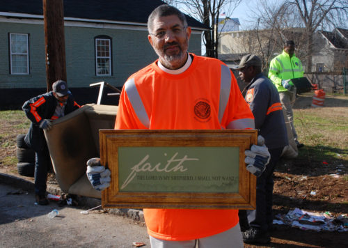 Bishop Rob Wright notes the irony of one discarded item. Photo: Don Plummer/Diocese Atlanta