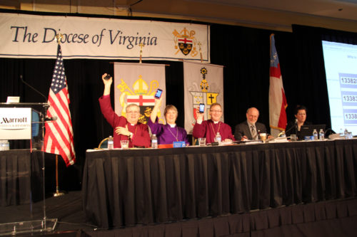 Virginia bishops the Rt. Rev. Ted Gulick, assistant; the Rt. Rev. Susan Goff, suffragan; and the Rt. Rev. Shannon Johnston, diocesan, lead the way in Virginia's interactive info-gathering session at their Jan. 2014 Annual Council – powered by text-response survey software. Photo: Megan-Drew Tiller