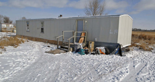 Debbie Dogskin, 61, was found dead Feb. 4 in this mobile home with an empty propane tank  in Fort Yates, North Dakota on the Standing Rock Reservation A nationwide propane shortage has hit the Sioux reservation that straddles the Dakotas' border particularly hard. A more than doubling of the fuel's cost has crippled efforts to stay warm -- and alive -- through the harsh winter where most people rely on propane to heat their often ramshackle homes. Photo: Tom Stromme, Bismarck Tribune, Associated Press
