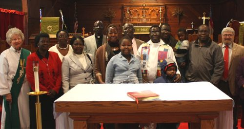 Members of St. John the Divine Episcopal Church, Moorhead, Minnesota (Diocese of North Dakota) gather with their new vicar, the Rev. Michael Paul, following the worship service on the Day of Prayer for South Sudan on Feb. 16. Photo: Joe Bjordal/Episcopal News Service