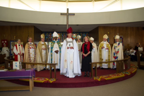 Bishop David Rice and his wife Tracy are joined in front of the altar by some of the bishops from the Episcopal Church's Province VIII dioceses. Photo: Kelvin Yee