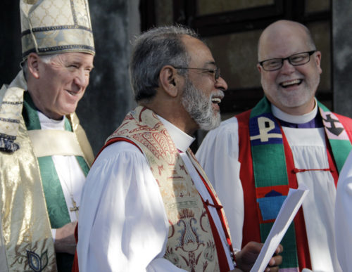 Archbishop Fred Hiltz, primate of the Anglican Church of Canada, Dominican Republic Bishop Julio César Holguín and Diocese of Eastern Michigan Bishop Todd Ousley in procession for the closing Eucharist. Photo: Lynette Wilson/Episcopal News Service