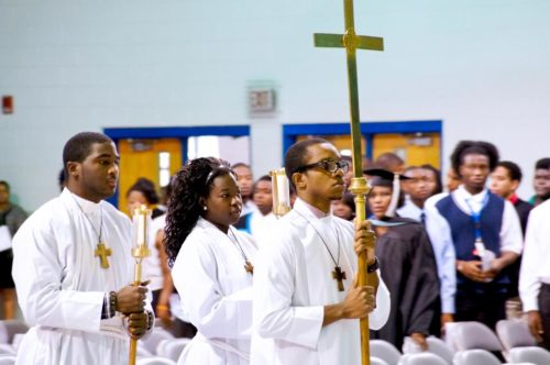 A procession during the opening convocation for 2012-2013 at Voorhees College, a historically black college affiliated with the Episcopal Church. Students at the South Carolina school often participate in worship at St. Philip's Chapel on campus, including as acolytes.