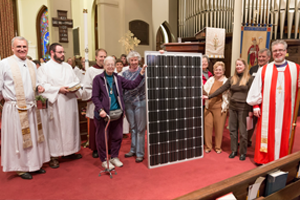 Texas Bishop Andy Doyle blesses a solar panel
