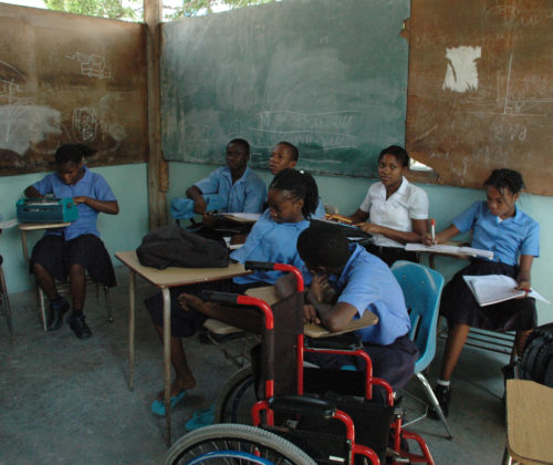 Even prior to the 2010 earthquake, students at the Episcopal Diocese of Haiti's St. Vincent's Center for Handicapped Children in Port-au-Prince, Haiti, stretched the space available at the school. Rebuilding plans call for more classrooms. Photo: Mary Frances Schjonberg/Episcopal News Service