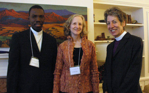 "Presiding Bishop Katharine Jefferts Schori March 10 hosted a reception to thank Mary White, center, for her ""lead gift"" to rebuild the Episcopal Diocese of Haiti's St. Vincent's Center for Handicapped Children in Port-au-Prince, Haiti. The center's director, Pere Sadoni Leon, left, later said White's gift will also rebuild the hope of the children at the school. Photo: Mary Frances Schjonberg/Episcopal News Service"