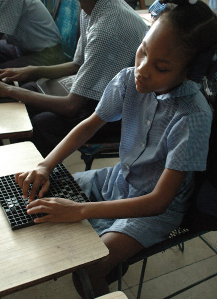 A student at the Episcopal Diocese of Haiti's St. Vincent's Center for Handicapped Children in Port-au-Prince, Haiti, studies braille in November 2008. The center is still the only place teaching braille to the blind in the country. Photo: Mary Frances Schjonberg/Episcopal News Service