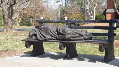 The crucifixion marks in the sculpture's feet are one of the only identifying features on the Homeless Jesus. Photo: Susan McCoy