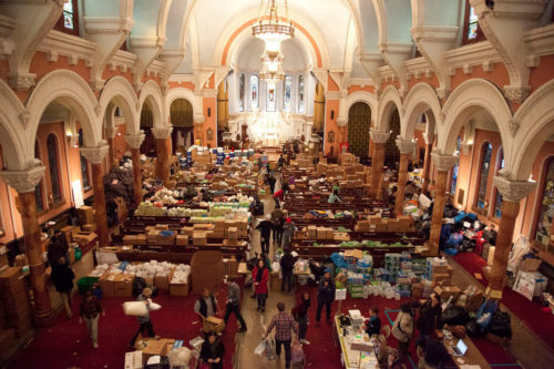 """""""This is what incarnate love looks like!,"""" says Church of St. Luke and St. Matthew in Brooklyn, New York on its Facebook page. The nave began being used as a distribution hub for supplies  shortly after Hurricane Sandy stuck. Photo: Church of St. Luke and St. Matthew"""