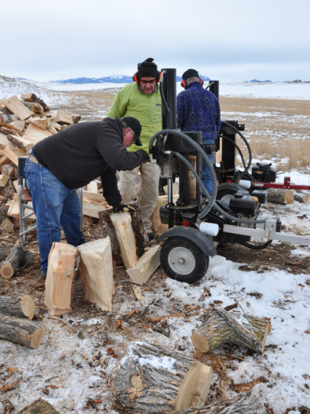 Tri Parish Wood Bank volunteers use log splitters to break up some of the last firewood of the ministry's 2013-2014 winter season. Photo: Mary Frances Schjonberg/ENS