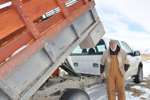 The Rev. Harry Neeley says hydraulic lifts for the Tri Parish Wood Bank's two trucks make deliveries much easier. Photo: Mary Frances Schjonberg/ENS