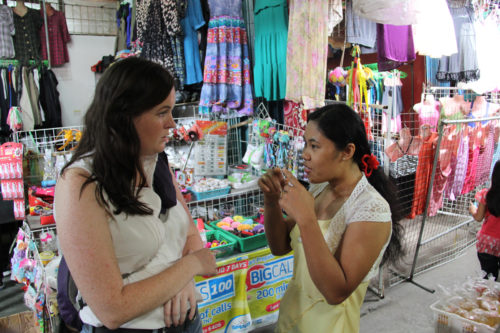 As part of her work with the Episcopal Development Foundation of St. Mark's in the Diocese of Santiago, YASCer Ashley Cameron visits with market shop owners who receive small business loans from the church foundation. Photo: Emily Cherry