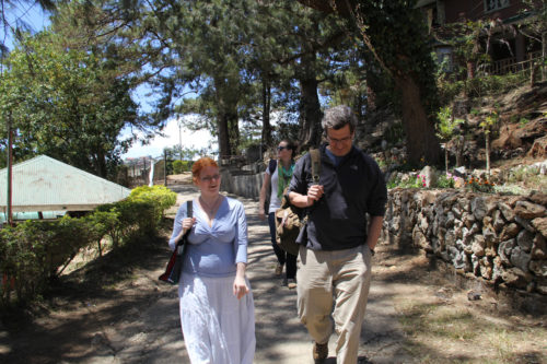 YASCer Margaret Clinch, pictured here with fellow YASCer Ashley Cameron and Buck Blanchard of the Diocese of Virginia, tours the grounds of Easter College in Baguio, where she's spending the year teaching. Photo Emily Cherry