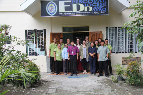 Staff of the Diocese of Davao, pictured here with Ashley Cameron of the Young Adult Service Corps and Emily Cherry and Buck Blanchard of the Diocese of Virginia, joined together in a disaster relief project following Typhoon Haiyan. Photo: Emily Cherry
