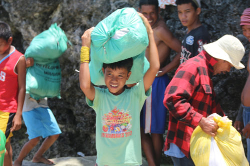 The island of Bantayan counts children in its team of volunteers. The Diocese of Davao supports a continuing relief and economic redevelopment project in Bantayan. Photo: Gideon Bustamante