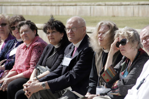Conference attendees, including Bishop James Curry, bishop suffragan in the Diocese of Connecticut, center, listen as a National Parks Service guide describes the events of the of April 19, 1995, Oklahoma City bombing. Photo: Lynette Wilson/ENS