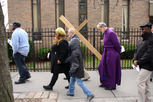 Casper Ewig of St. Paul's in Bergen carries the cross as Bishop Mark Beckwith and others follow. Photo: Nina Nicholson