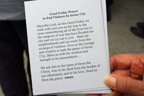 Prayer cards were handed out to residents along the route. Photo: Nina Nicholson