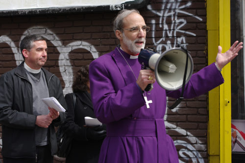 Bishop Mark Beckwith addresses the group at the end of the procession, while the Rev. Thomas Murphy of St. Paul's in Bergen looks on. Photo: Nina Nicholson