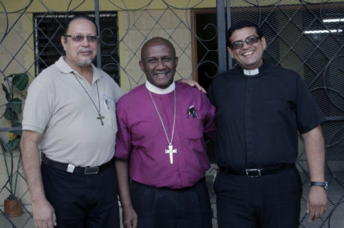 The Rev. Roberto Martinez Amengual, Bishop Lloyd Allen and Victor Manuel Velasquez at Manos de Dios in Danli. Manos de Dios serves as a model of self-sustainability for the rest of the diocese. Photo: Lynette Wilson/ENS