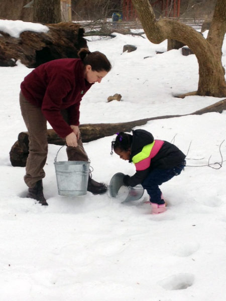 Youngsters in the Ark preschool for homeless children operated by Episcopal Community Services of Maryland had an opportunity to play in the snow during a monthly field trip to the Irvine Nature Center outside Baltimore. Photo: ECS