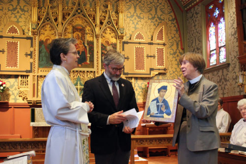 The Rev. Amelia Hagen, left, gives the Frances Perkins icon to St. Andrew's Episcopal Church in Newcastle, Maine. The Rev. Lu-Anne Conner, St. Andrew's rector, and Tomlin Coggeshall, Perkins' grandson, accept the gift. Photo: Heidi Shott