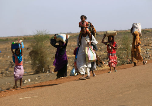 South Sudanese flee an attack on the South Sudanese town of Renk, arrive at a border gate in Joda, along the Sudanese border, April 18. Photo: Mohamed Nureldin Abdallah/Reuters